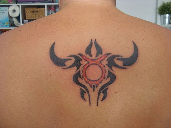 Tribal Taurus Tattoo On Man Upperback