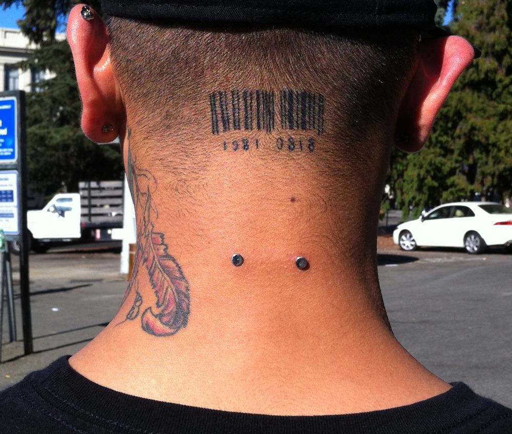 Nape Piercing And Back Neck Scissor Tattoo
