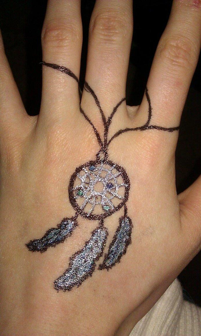 dreamcatcher tattoo on left hand