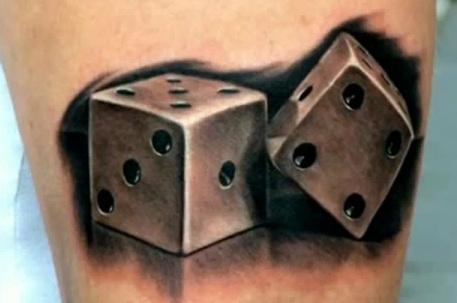 Grey Ink Dice Tattoo