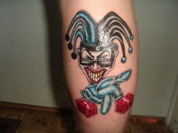 Joker Head And Red Dice Tattoos On Back Leg