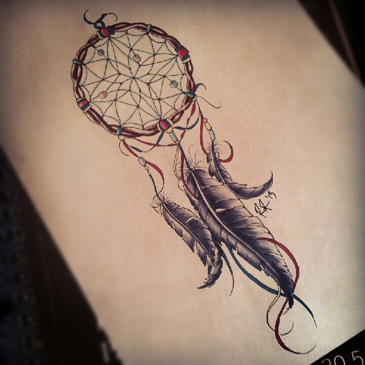 Horse shoe and dreamcatcher tattoo on side rib