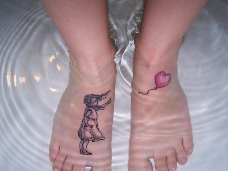 Girl Showing Her Foot Tattoo