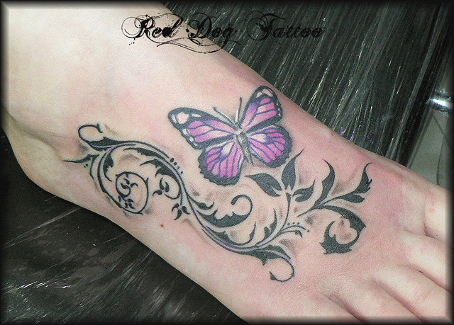 Vine leaves and purple butterfly feet tattoo for Purple butterfly tattoo
