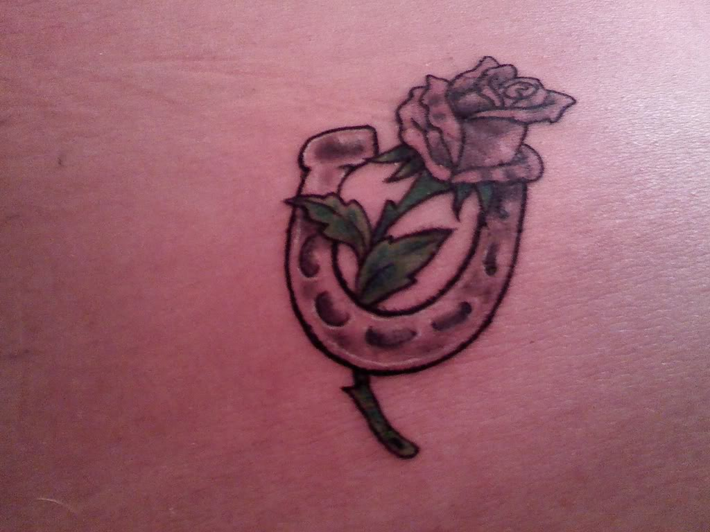Grey Rose Flower And Horse Shoe Tattoo