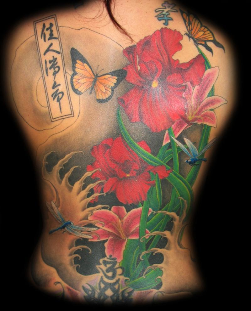 Purple flowers iris tattoo on sleeve red flowers iris tattoo izmirmasajfo Images