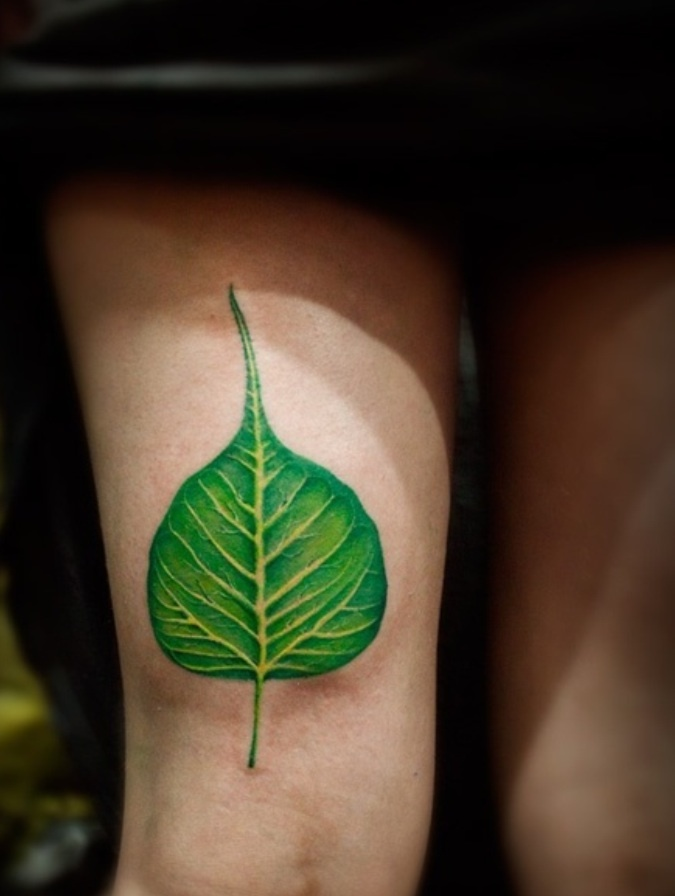 Green Peepal  Leaf Tattoo On Thigh