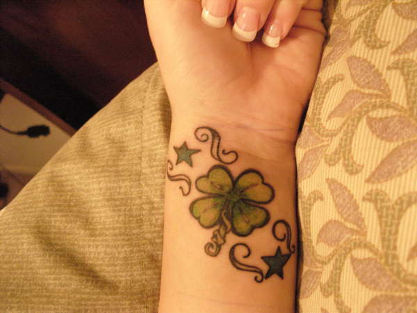 Stars And Leaf Tattoo On Left Wrist