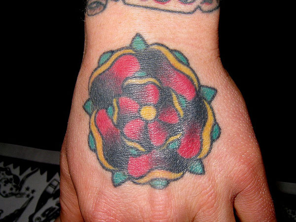 Texas flower tattoo on left hand for Flower tattoos on hand
