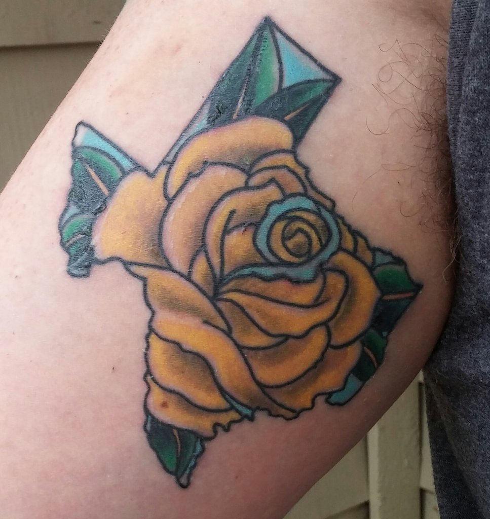 Yellow rose and texas tattoo on sleeve yellow rose flower and texas tattoo mightylinksfo