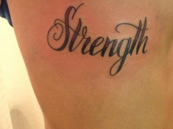 Black Ink Strength Word Tattoo