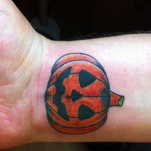 Pumpkin tattoo on right wrist for Tattoos of pumpkins