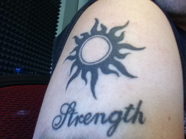 Tribal Sun And Strength Tattoo On Shoulder