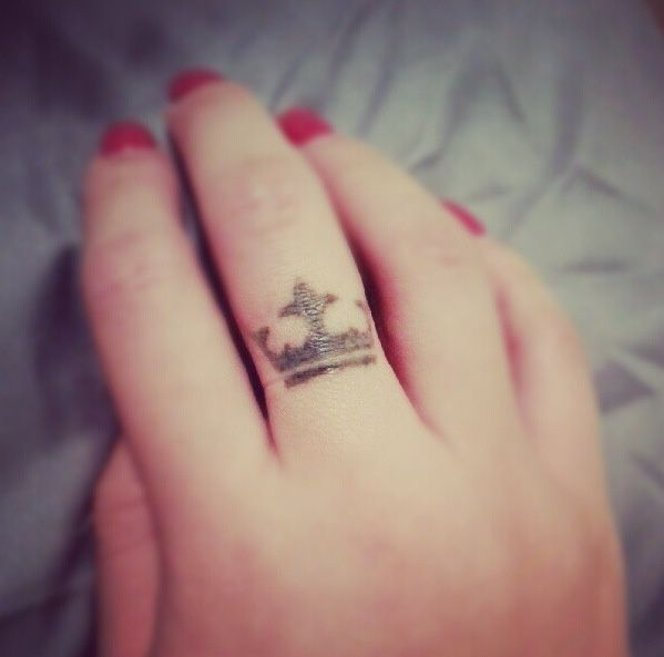 Small tiny crown tattoo on finger
