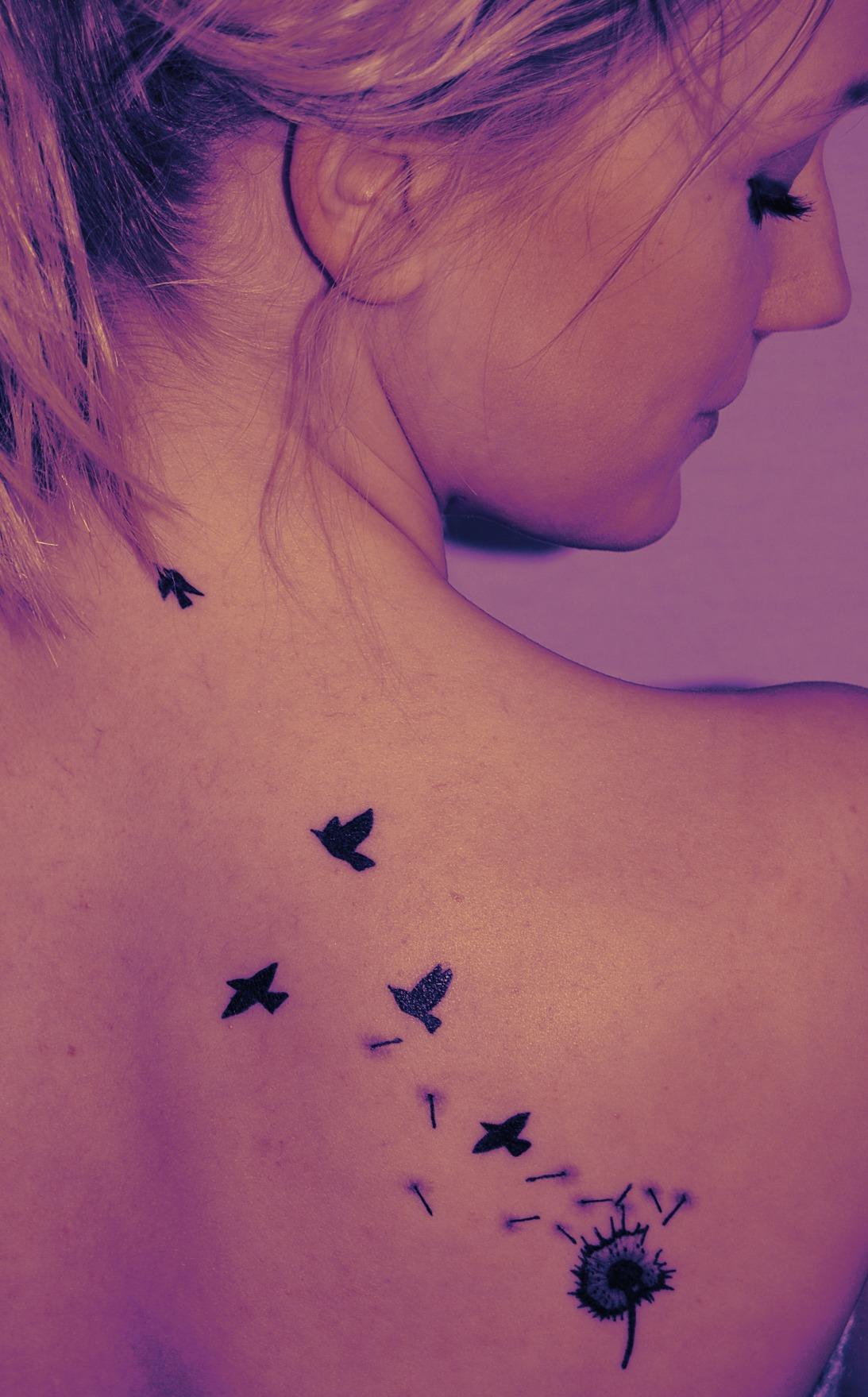 Dandelion Puff And Flying Dandelion Bird Tattoo On Side