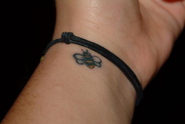 Tiny Bee Tattoo On Left Wrist