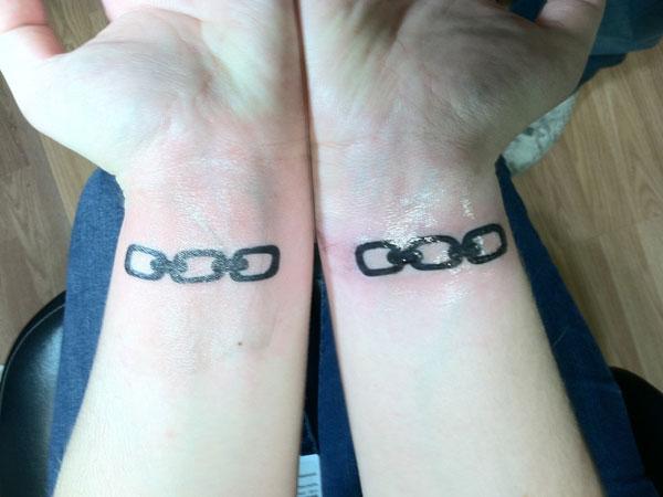 Chain Tattoo On Wrist: Black Ink Chain Tattoos On Wrists
