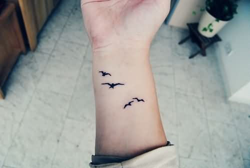62093d9b5 Black Birds Flying Wrist Tattoo For Girls
