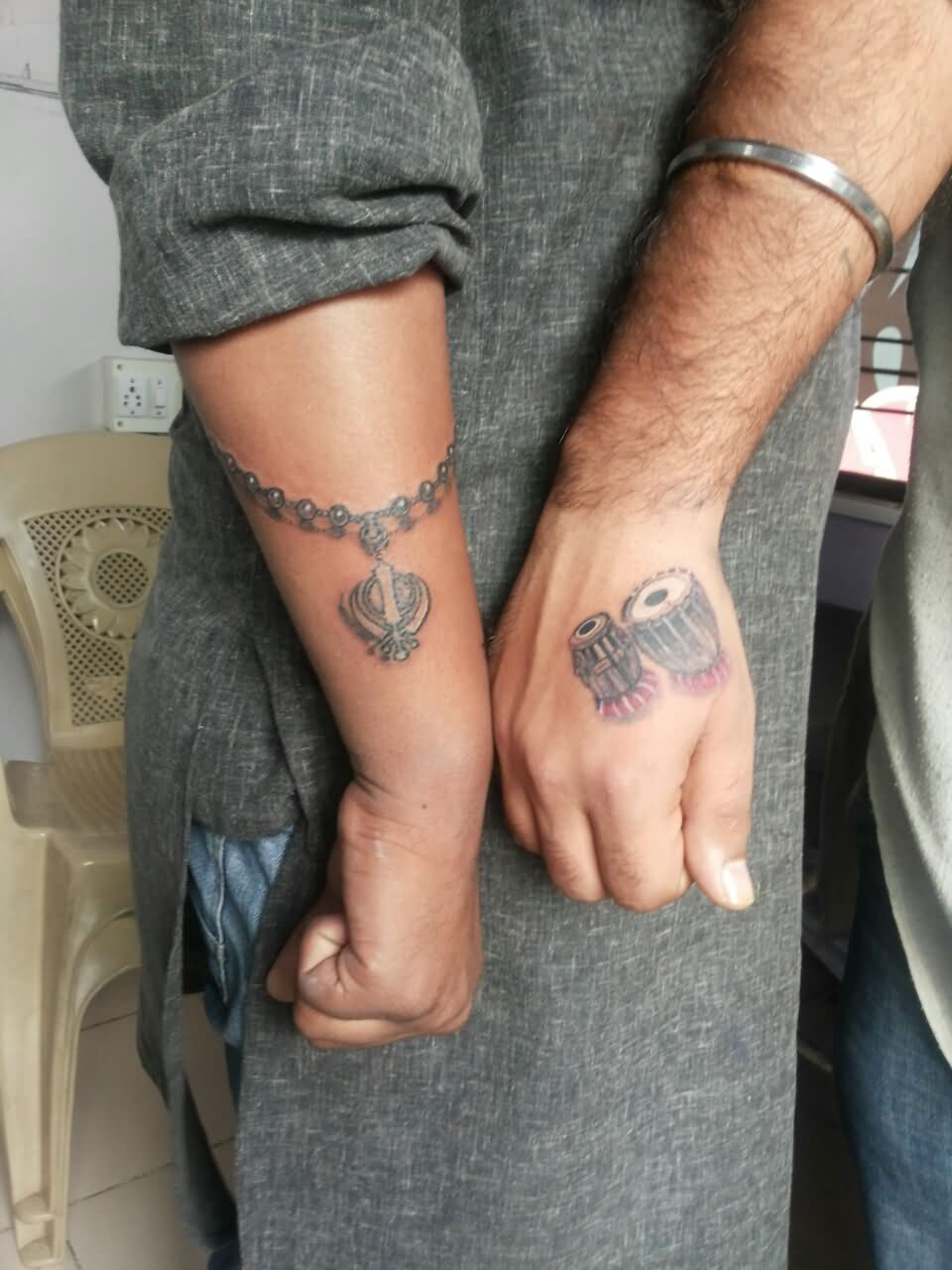 Grey Ink Khanda With Chain and Tabla Tattoos