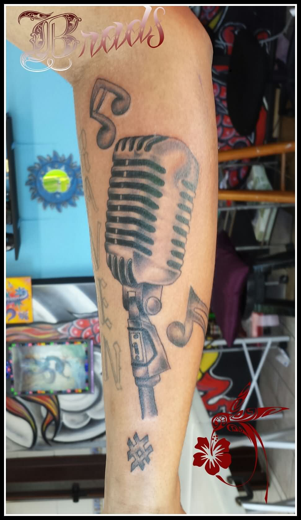 Grey Ink Old School Mic Tattoo On Sleeve