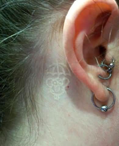 White Ink Tattoo Behind Ear