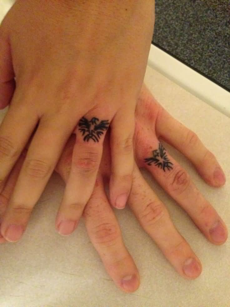 Awesome wedding band tattoos on fingers for Wedding tattoos on fingers