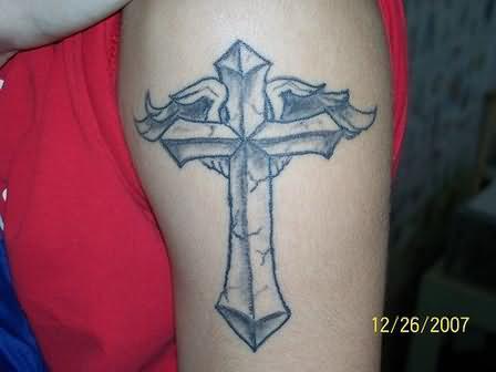 Elegant cross tattoo on bicep for Elegant cross tattoos for women