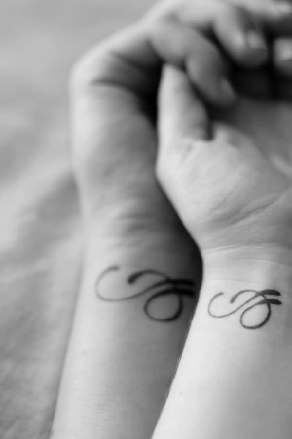 Black Ink Couple Tattoos On Wrists