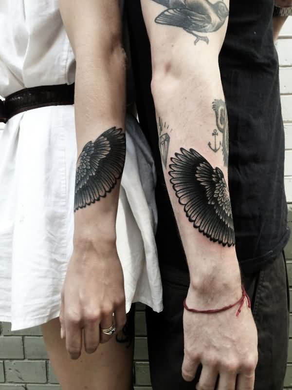 Grey Ink Couple Tattoos on Arms