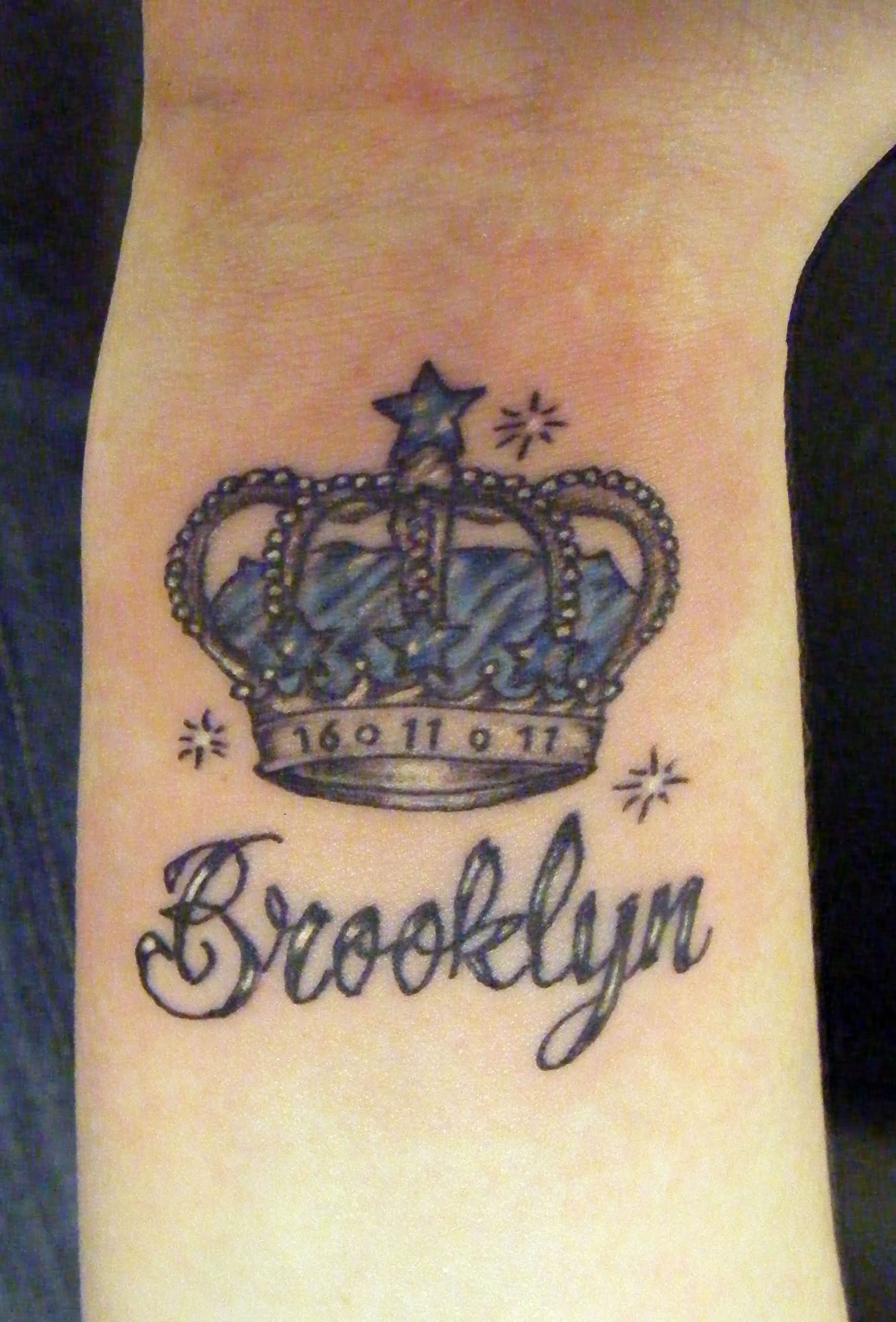 Memorial Queen Crown Tattoo On Right Wrist