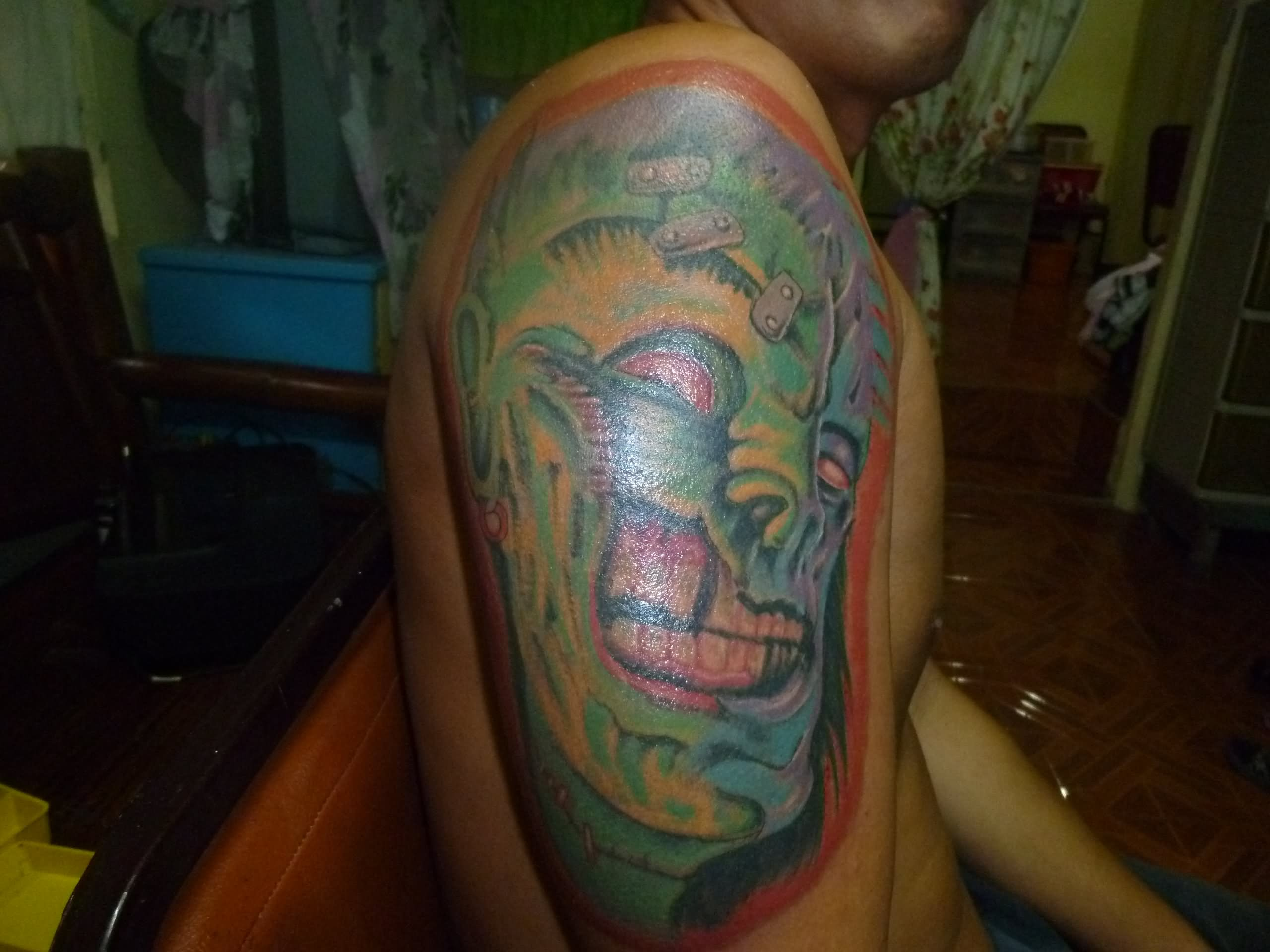 Colorful Zombie Face Tattoo On Half Sleeve