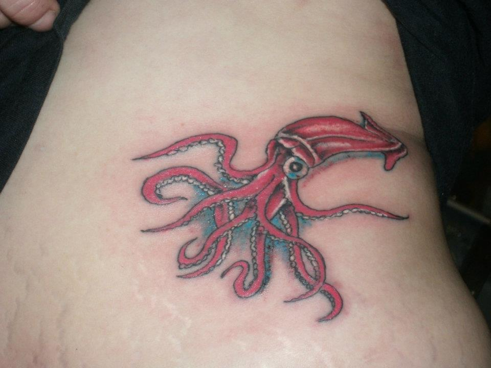 Red Ink Octopus Tattoo On Side Rib