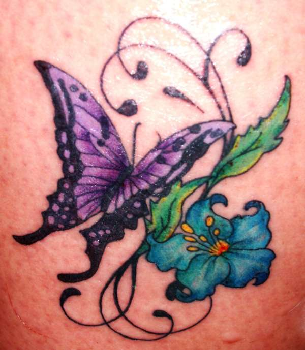 Butterfly And Flower Tattoo On Hip