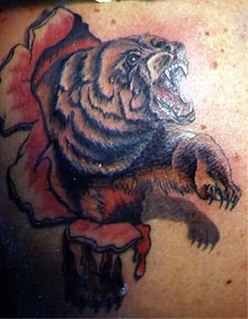 Ripped Skin Bear Tattoo