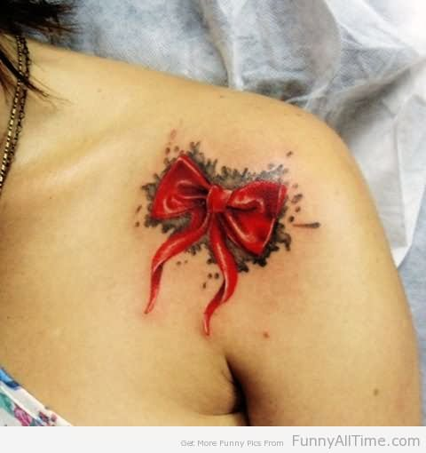 Cute red bow tattoo on collarbone for Looking glass plastic surgery tattoo removal