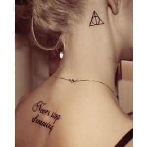 Hallows Tattoo On Side Thigh
