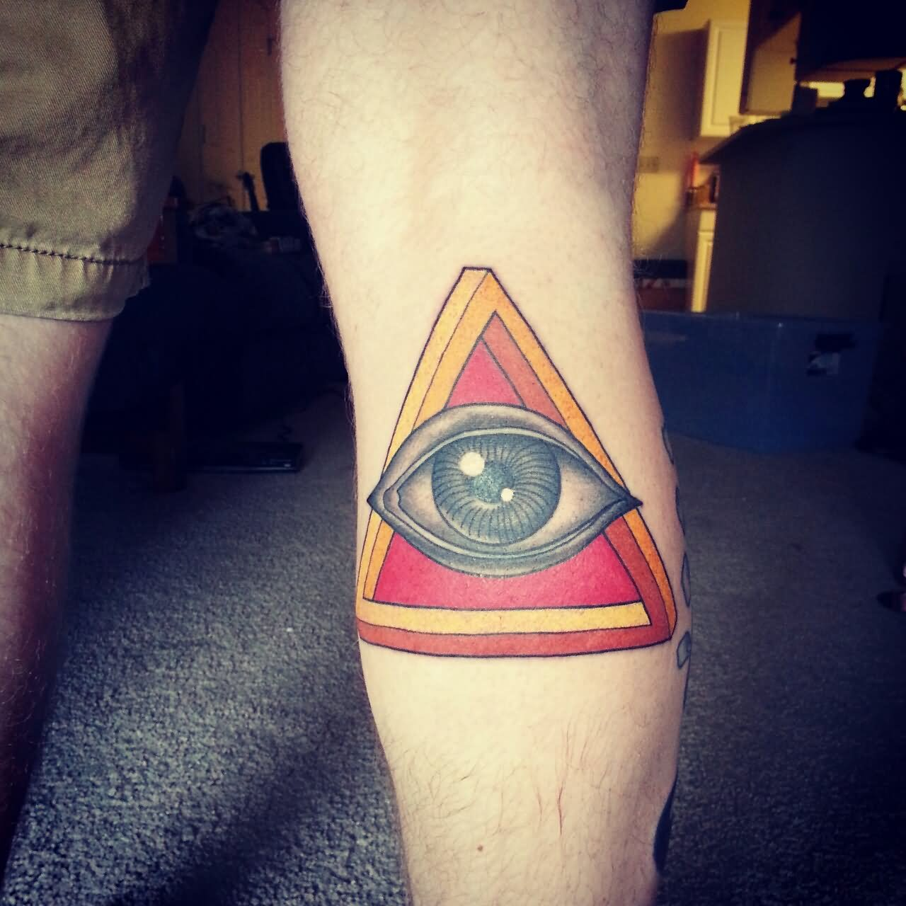Color Ink Triangle Eye Tattoo On Back Leg