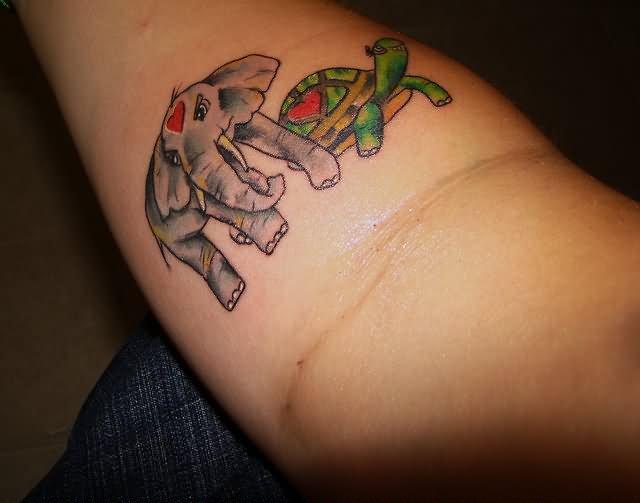 Elephant And Turtle Tattoo On Arm