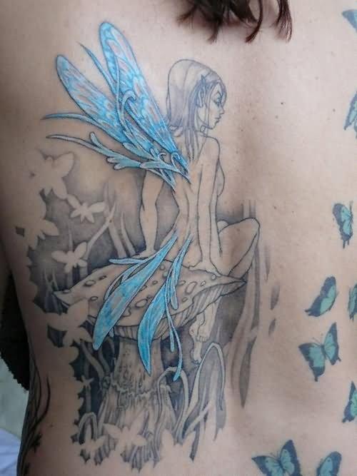6ae050654a36c Fairy Girl Sitting On Mushroom Watercolor Tattoo