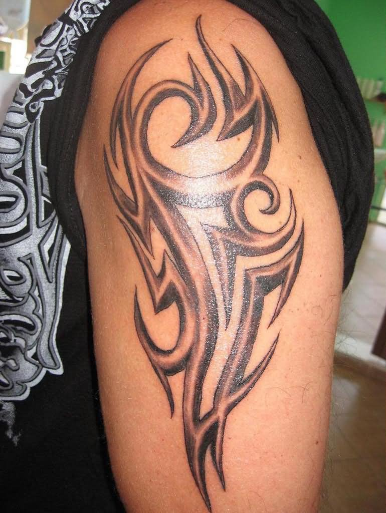 Tribal-Tattoos Black-And-Grey-Ink-Tribal-Tattoo-On-Left-Half-Sleeve
