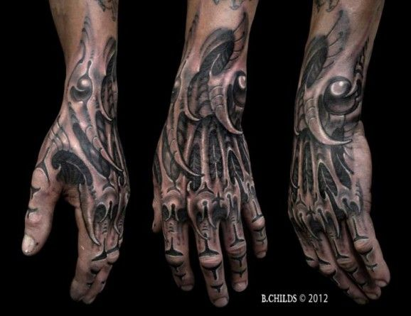 Black Ink Bio Mechanical Hand Tattoo By B. Childs