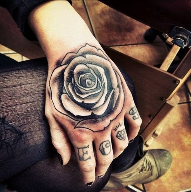 Black Ink Rose Tattoo On Hand