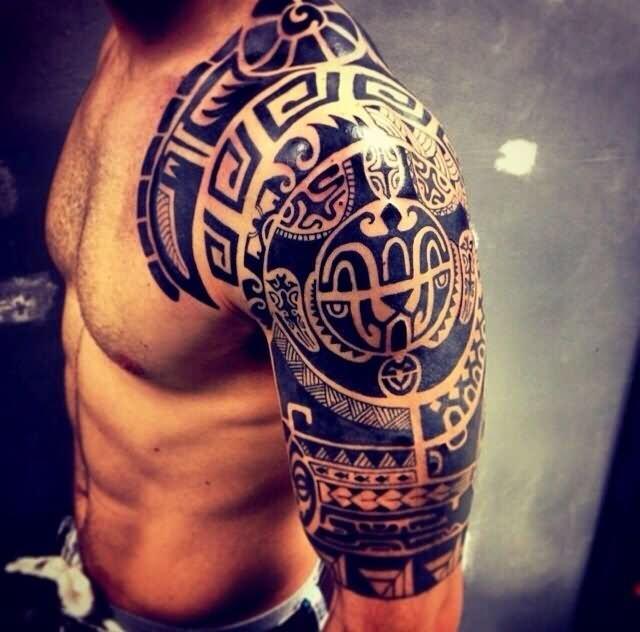 Black Ink Tribal Tattoo On Man Left Half Sleeve