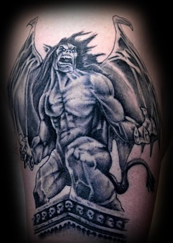 Evil Looking Gargoyle Tattoo On Bicep
