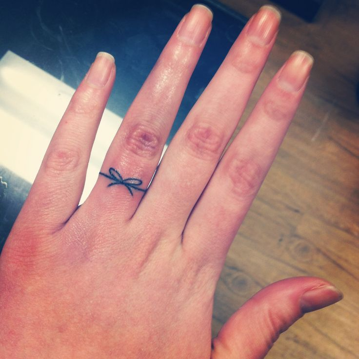 Knot Shaped Ring Tattoo For Girls