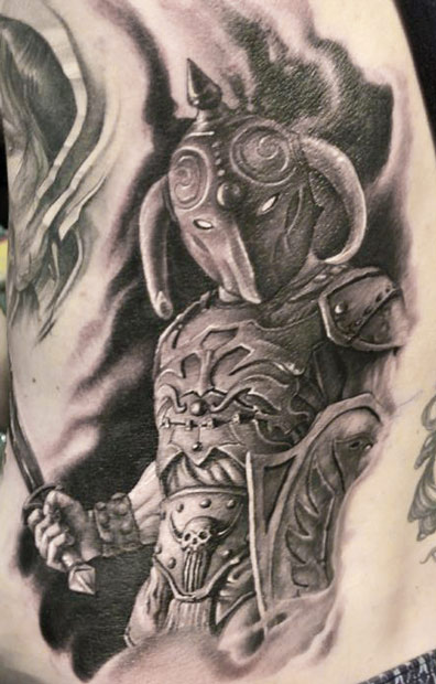 Realistic armed warrior tattoo on siderib by James Tattooart
