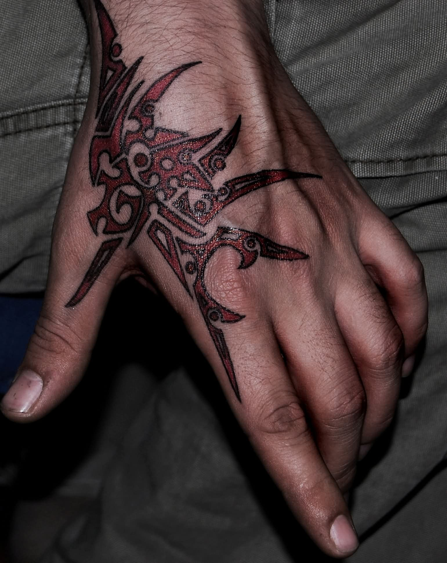 Tribal-Tattoos Red-Ink-Tribal-Tattoo-On-Left-Hand