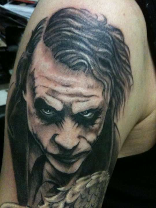 Black Ink Heath Ledger's Joker Tattoo African Lion Footprints