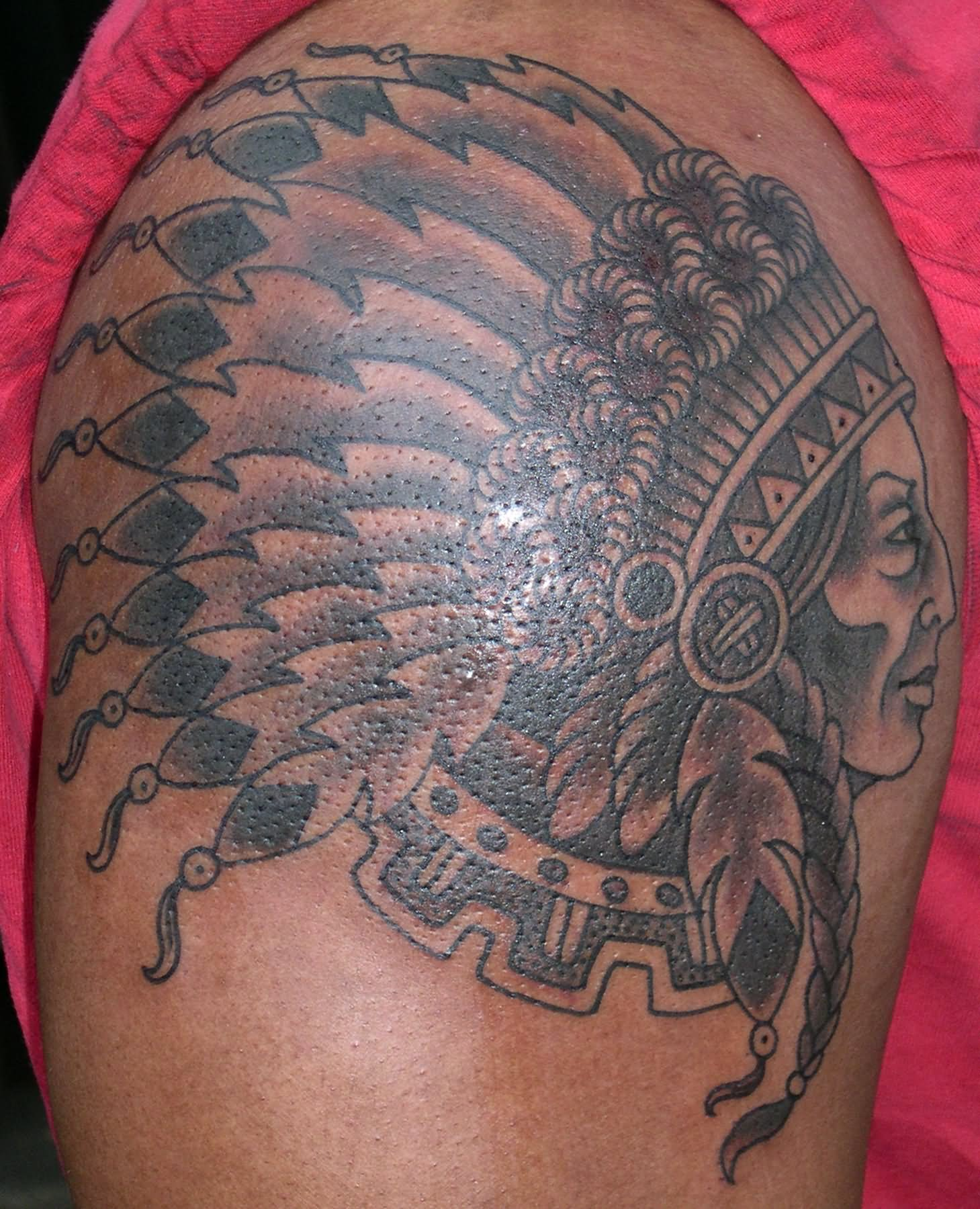 Grey ink native indian tattoo on shoulder for Indian ink tattoo