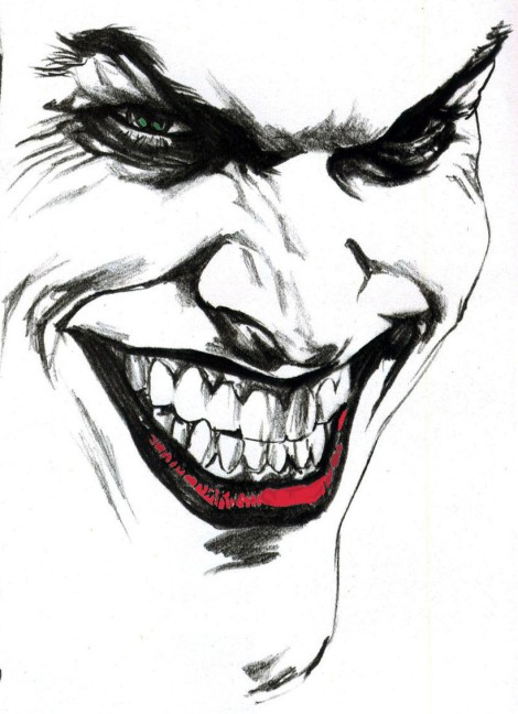 Black ink laughing joker tattoo